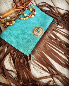 A personal favorite from my Etsy shop https://www.etsy.com/listing/248948426/ooak-turquoise-leathercowhide-clutch