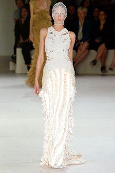 Sarah Burton for Alexander McQueen - each piece wholly original.  Love the white patterns.