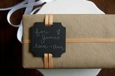 Craft paper wrapping with shaped gift tag