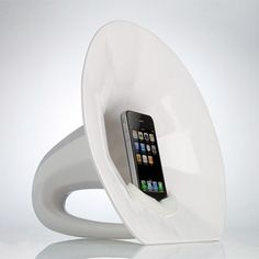 This is a ceramic amplifier designed specifically for the iPhone.  It's a speaker basically, but it looks like an old phonograph sculpture.  Phonofone III by Science and Sons.