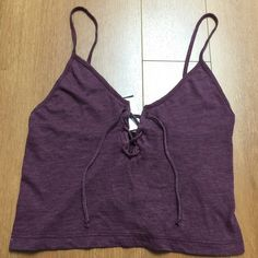"""Brandy Melville (John Galt) Burgundy Bethany Tank Soft cotton ribbed knit tank in burgundy with a tie detailing front and a cropped fit 17"""" length, 13"""" bust Size: small Made in USA Color: Burgundy New with tag #447 N Brandy Melville Tops Crop Tops"""