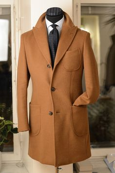 Unconstructed overcoat in camel Loro Piana fabric.