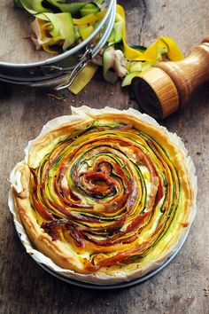 multicoloured tarte with vegetables and ham.