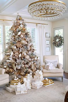 christmas tree paper A soft flocked Christmas tree anchors this luxe holiday living room. Enhance it with faux flower blooms, ribbons, and loads of ornaments. Gift boxes, rather than paper wrappings, coordinate with the decors color scheme. Elegant Christmas Trees, Flocked Christmas Trees, Christmas Tree Themes, White Flocked Christmas Tree, Frosted Christmas Tree, Silver Christmas Decorations, Christmas Mantles, Christmas Living Rooms, Christmas Room