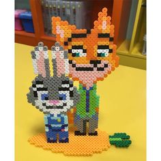 Nick and Judy - Zootopia perler beads by coaljjang - https://de.pinterest.com/pin/374291419012854322/