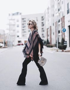 Enjoy a throwback to the '70s, and slip into a pair of flare jeans. Pair your bell-bottoms with any blouse, poncho, sweater, or T-shirt. To help lengthen your legs, we recommend a pair of heels like Mary's of Happily Grey.