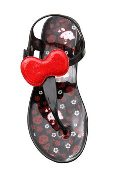 HELLO KITTY GLITTER BOW JELLY SANDALS  $19.50  These buckle strap jelly sandals feature red glitter bows and a Hello Kitty floral sugar skull pattern foot bed.