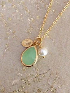 A personal favorite from my Etsy shop https://www.etsy.com/listing/492373579/pearl-initial-bridesmaid-jewelry-mint