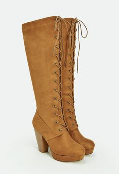 Who can resist a lace up faux suede bootie?! This style combines both sass and comfort with its chunky heel and front platform, perfect for all day wear.  ...