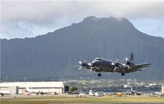 A Royal Canadian Air Force CP-140M Aurora takes off on a training mission from Marine Corps Base Hawaii during RIMPAC Exercise 2014 on July 15, 2014.