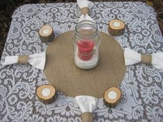 Table setting ideas. Blue accent pieces instead such as blue candles and blue napkins. I want a plain white tablecloth too.