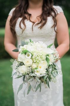 White wedding bouquet idea - white + green bouquet with hydrangeas, roses, ranunculuses, calla lilies + greenery {Rockhill Studio}