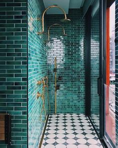 Could you go green?! All green + brass?   — also 12 rugs 25% off on the blog today!!  @jessklinglefuss via @designsponge. Green tile bathroom with brass fixtures.