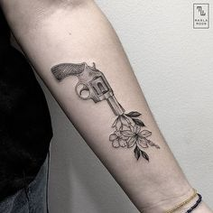 Blackwork tattoo revolver with flowers by Marla Moon @marla_moon in Madrid, Spain.