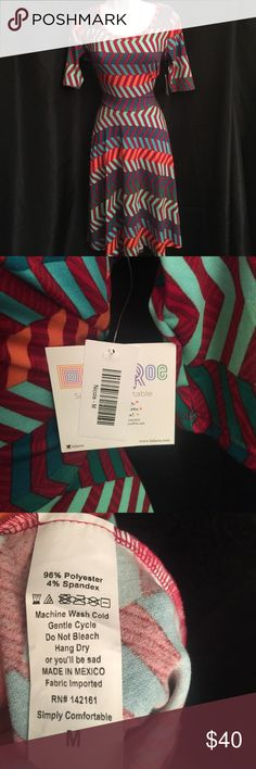 Brand New Lularoe Nicole Dress SZ M Arrow Print Brand New with tags! Sz M Lularoe Nicole Dress with Arrow Print Priced below Retail LuLaRoe Dresses
