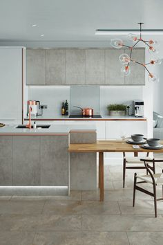 Create a characteristic look and transform your kitchen with our NEW concrete accent range. For more inspiration, visit Howdens.