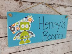 Hey, I found this really awesome Etsy listing at http://www.etsy.com/listing/155324128/personalized-robot-kids-door-sign-or