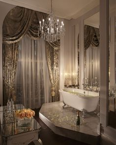 gold damask curtains and mirrored furniture