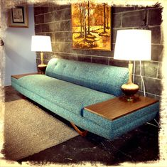 Love the legs and built-in end tables on this Adrian Pearsall blue tweed sofa - via Etsy.