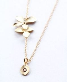 This delicate trio orchid necklace will add elegance to any dress.    The length of drop portion can be adjustable by simply moving trio orchid up or down. The leaf is custom made with any initial of your choice.    The chain and findings are sterling silver and with white gold plated orchids. $59 Orchids, Initials, Delicate, Gold Necklace, White Gold, Drop, Sterling Silver, Inspired, Chain