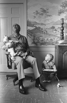 Lyndon B. Johnson sings with his grandson and his dog Yuki.  From the National Archives