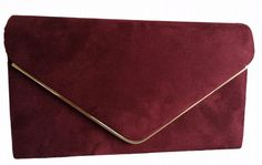 A burgundy coloured faux suede clutch bag shoulder bag The bag fastens with a flap over the top and a concealed metal magnetic stud it has a