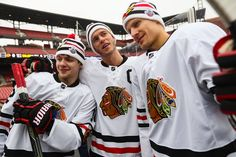 Artemi Panarin, Jonathan Toews and Richard Panik pose for a photo. #2017WinterClassic