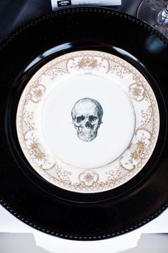 Skull wedding plates: http://www.stylemepretty.com/little-black-book-blog/2014/10/31/rock-romance-skull-detailed-vancouver-wedding/ | Photography: Whitney Lane - http://whitneylanephotography.com/