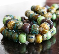 31/0 Aged Tribal Striped Picasso Czech Glass by BobbiThisnThat