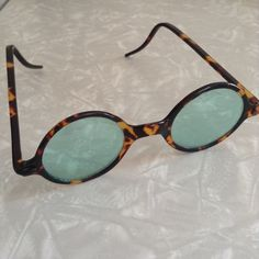 ✨POST✨VINTAGE celluloid Gatsby sunnies - 1920s!! Legit flapper era sunglasses! In fabulous condition - tortoise shell celluloid frames with teal tinted lenses. Right temple not as straight as the left (see slight curve in second image), which isn't noticeable when wearing but you might be able to get it adjusted at an eyewear shop. Posted 12/28 Vintage Accessories Sunglasses