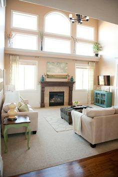 I liked this reminder of my favoriet basic style: nuetral, lots of light, with bits of color that are easy to change up. Simple, practical, non-fussy and realistic!  Love the light in this house.