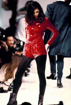 Model wearing velvet red ensemble on the catwalk for Katharine Hamnett  Autumn / Winter 1989 collection at London Fashion Week.