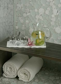 Artistic Tile | Enjoy a tranquil spa day surrounded by the whimsical Effervescence glass and marble mosaic.  Effervescence is stocked in three colorways and can also be customized for a truly unique statement.