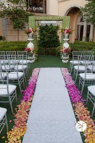 Garden party wedding in Las Vegas, ceremony and aisle decor. Flowers by Enchanted Florist www.efilasvegas.com