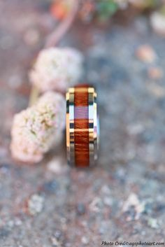 Beautiful Tungsten wood wedding band. This mens ring is crafted out of 100% real koa wood. This picture was captured by the best photgrapher in California AGS Phot Art.