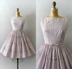 Darling vintage 1950s Lanz dress, blue and pink heart print cotton body, fitted bodice, tank style shoulders, fitted waist with attached belt, full tiered skirt with bow details, back button closure - - - M E A S U R E M E N T S - - - Fit/Size: S Bust: 36 Waist: 26 Hips: free Length: 39 Maker/Brand: Lanz Condition: Near excellent with light discoloration to a few of the buttons. - - - - - - - - - - - - - - - - - - - - - - - - - - Instagram: sweetbeefinds Facebook: sweet bee fi...