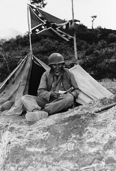The confederate flag waves from top of pup tent of SFC Eugene L. Bursi, of Memphis, Tenn., an artilleryman with the 136th Field Artillery Battalion U.S. Eighth Army, in Korea on April 27, 1951. (AP Photo) American Soldiers, American Civil War, American History, Southern Heritage, Southern Pride, Simply Southern, Southern Style, Confederate Flag, Korean War