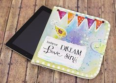 Colorful & Inspirational Stenciled Tablet Case | Carry inspiration and an electronic device with you in this colorfully whimsical case. #decoartprojects #decoartmedia #mixedmedia