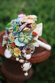 Wedding bouquet made from costume jewelry. Great way to use your family's unused pieces-this bouquet could be handed down through the family:)