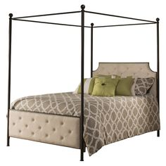 Avant-garde style meets romantic detailing in the canopy bed. Finished in an antique brown and boasting a natural linen, button-and-tuck, fabric-covered headboard and footboard, the metal bed is an old school glamour canopy bed with modern sensibilities. Requires a mattress and box spring.