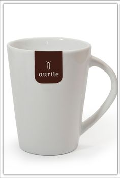 Aurile Mug £6.49. Simple decorated with the stylish Aurile logo. Perfect for those, who realise that Aurile is not only delicious coffee but also a unique lifestyle. It is designed for presentations and tastings, it is useful not only at home and at work, but also in bars and cafés. - smooth porcelain - individually selected elements - hand applied motif - dishwasher safe - capacity: 350 ml