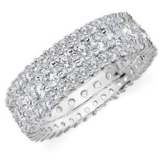A stunning stackable eternity ring made of one 2.0 CTTW Shared Prong Eternity Ring in the center and a .50 CTTW Shared Prong Diamond Eternity Ring on each side.