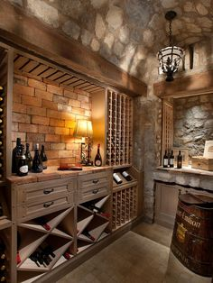 Stone, brick, and wood combine to create this neutral wine cellar filled with rustic charm. A metal pendant light hangs from the ceiling adding to the rooms old world feel.