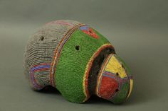 Africa | Clay head adornment – Karamojong,Northern Uganda. | Human hair and clay decorated with natural pigments.The form of the hat also resembles an animal,possibly the pangolin.