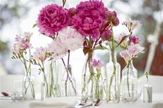 Love the non-uniform jars and arrangement of these luscious pink peonies
