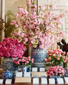 The escort-card table was decked out with blue-and-white Canton and chinoiserie vases and a profusion of cherry blossoms an iconic Washington D. mirrored risers were set out to display calligraphed envelopes holding escort cards and later sweets.