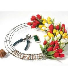 Make a Floral Wire Wreath. The dollar store sells these wire wreaths! Learn how to craft beautiful wreaths, floral arrangements, hair pieces, and more at JOANN's. Tulip Wreath, Hydrangea Wreath, Floral Wreath, Wreath Crafts, Diy Wreath, Wreath Ideas, Grapevine Wreath, Wire Wreath Frame, Diy Spring Wreath