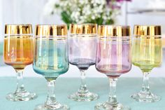 These are some of the prettiest glasses we've found in a while! 'Set of 5 vintage multi-coloured glasses: sherry / port / aperitif glasses, pretty harlequin glasses for a special party on Etsy, £13.40'