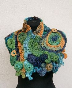 This beautiful and one of a kind freeform crochet scarf was made out of wool and acrylic This is one of a kind product, no other item is the same. Please e-mail if you have any questions. Thank you for looking. shawl, stole, collar, cape stole fastened with 2 buttons very nice,