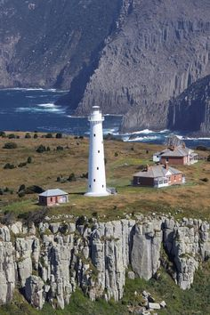 The Tasman Lighthouse is off the south-eastern coast of Tasmania, Australia. It…